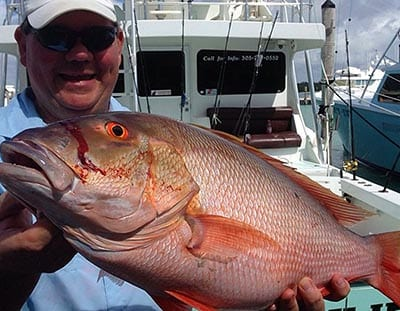 Happy fisherman with the Mutton He caught on a 3/4 day fishing charter